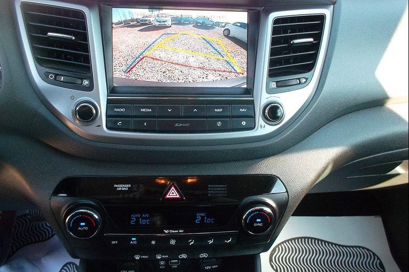 Photo 6 de l'offre de HYUNDAI TUCSON 1.7 CRDI 115CH BUSINESS 2WD à 14500€ chez François-Pierre automobiles