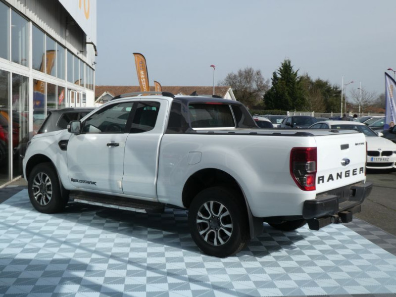 Photo 4 de l'offre de FORD RANGER SUPER CAB 2.0 TDCI 213 BVA10 4WD WILDTRAK Cover Pack Tech. 32875HT à 39450€ chez Mérignac auto