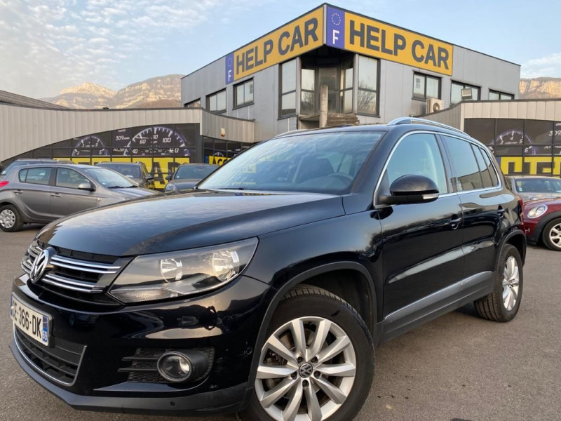 Photo 1 de l'offre de VOLKSWAGEN TIGUAN 2.0 TDI 110CH BLUEMOTION TECHNOLOGY FAP SPORTLINE à 15490€ chez Help car