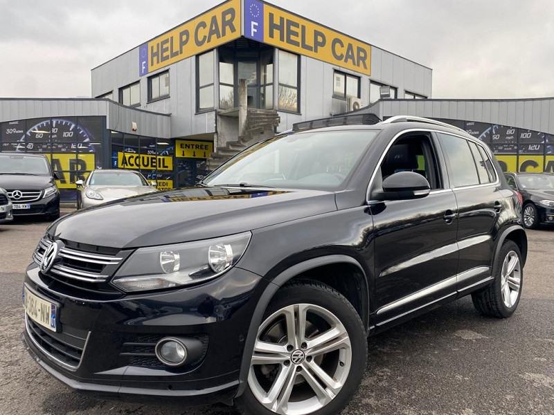 Photo 1 de l'offre de VOLKSWAGEN TIGUAN 2.0 TDI 140CH BLUEMOTION TECHNOLOGY FAP R LINE à 14990€ chez Help car