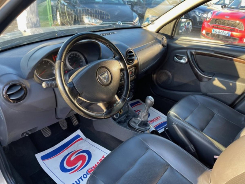 Photo 11 de l'offre de DACIA DUSTER 1.6 16V - 105 4X4 PRESTIGE CLIM CUIR à 8990€ chez Triplo auto